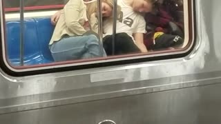 Two girls passed out on man on subway - Video