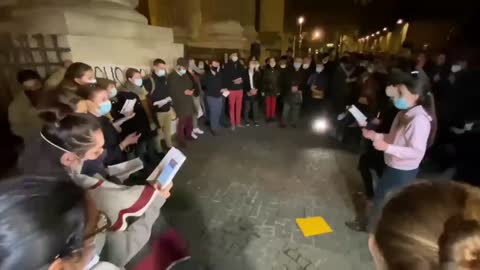 Catholics pray in front of Saint-Sulpice church in Paris to demand the return of Masses