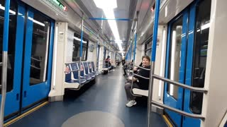 Guy Rides Bicycle in Metro Train