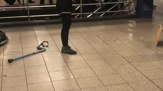 One legged woman dancing in subway station