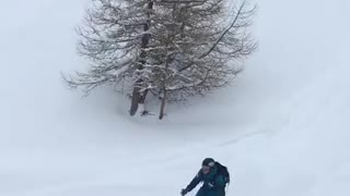 Skier does back flip but fails and face plants into snow