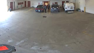 Watch How This Witty Perp Escapes Police Car Through Garage Doors - Video