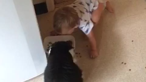 Baby hilariously imitates cat's eating habits