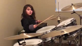 Little Girl Plays The Drums