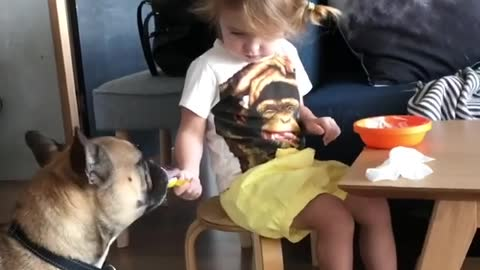 Charming Little Girl Shares Yummy Breakfast With Her Doggy
