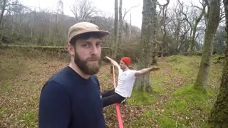 Collab copyright protection - man looks at camera slackline fall - Video
