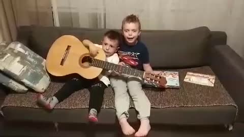 Little brother duo attempt to sing Spanish song