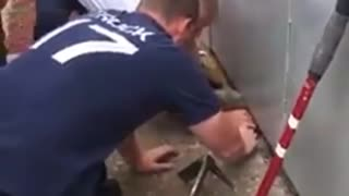 They saved the cat from the stuck place. - Video