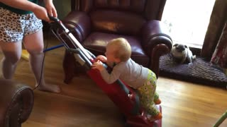 "Baby ""helps"" mom vacuum the house"