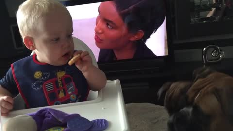 Baby's mind is completely blown after handing dog a cookie