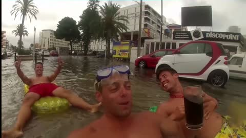 Guys get crazy in Ibiza after the big rain