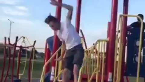 A boy jumps from one playground roof to other