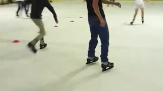 Guy in black shirt and black hat rollerblading loses balance and falls backwards - Video
