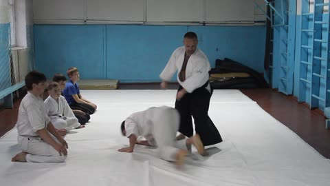 Aikido. New attack defense method. Sensei is showing a new trick.