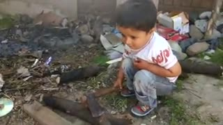 Very Small boy Playing with Axe  - Video