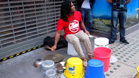 Awesome street artist playing 'drums'