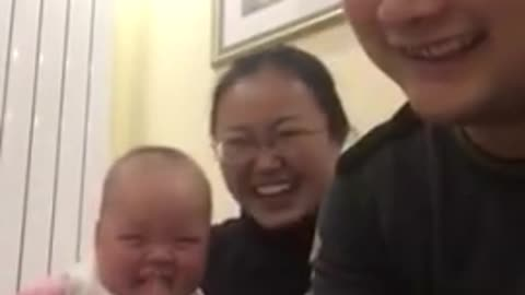 Cute Baby Laughs at Dad Counting Money