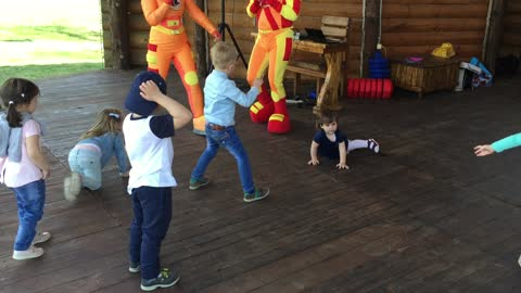 The child dances very funny