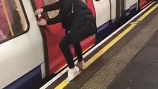 Woman pretends to stop train by pulling door