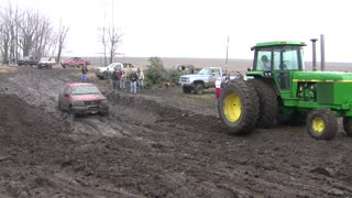 John Deere Trying To Pull Truck From Mud