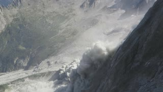 Massive Rockfall  Peels Off Mountain Face Leaving People In Awe - Video