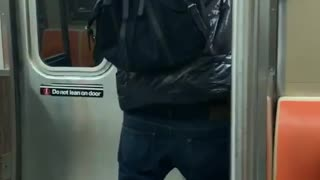 Guy dancing on the subway