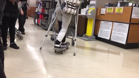 Woman on crutches uses skateboard to push shopping cart