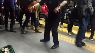 Old man in black dancing in subway station - Video
