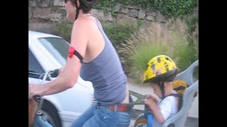 Toddler Gives Mom A Wedgie While She Rides A Bike - Video
