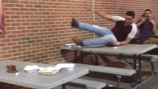 Michigan vs penn state guy tries to jump on table ripped jeans red shirt - Video