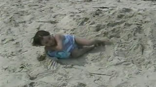 Little Girl Fills Bathing Suit With Sand