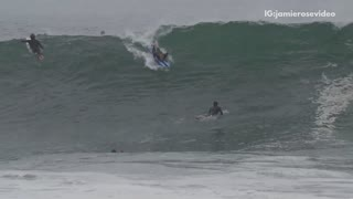 Guy blue surfboard wipes out huge wave - Video