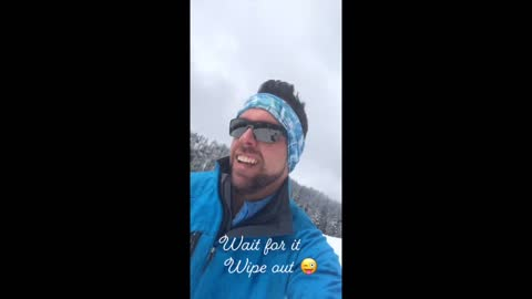 snowboarder gets wiped out while taking selfie