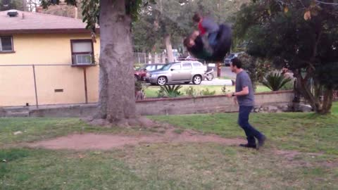 Silly Dad's Tire Swing Stunt Ends Badly For Him
