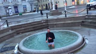 Guy black shirt in water fountain