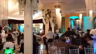 Music guy in grey dress shirt falls out of wedding dance line
