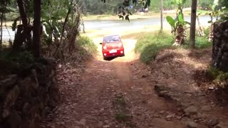 small car in the road  - Video