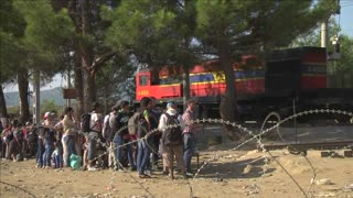 Migrants wait to cross into Macedonia from Greece - Video