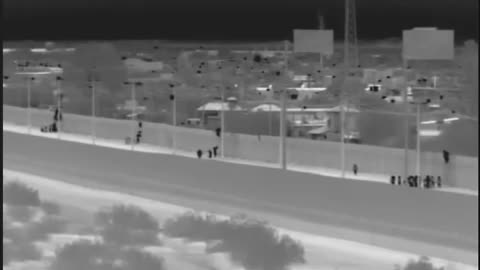 Migrants captured after dropping over border wall