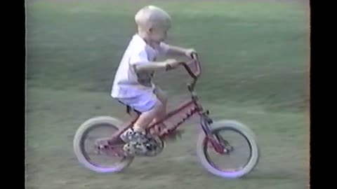 Kid Learning To Ride Bike Pedals Right Into A Truck