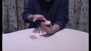 A Match Eerily Floats Suspended On A Playing Card - Video