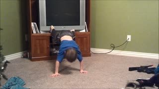 Kid can't quite grasp concept of push-ups - Video