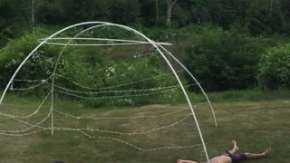Boogie board slip and slide into tent poles - Video