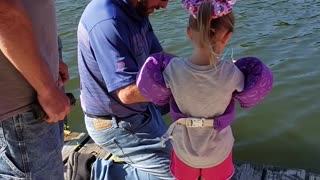 Little Girl Reels in Monster Fish with Mini Pole