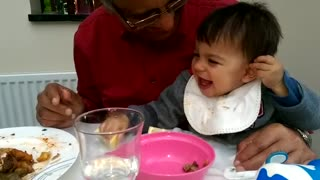 Baby has mixed feelings after lemon tasting - Video