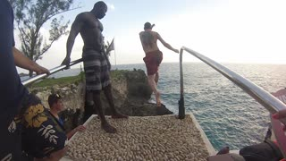 Jumping from the cliff at Rick's Cafe in Jamaica