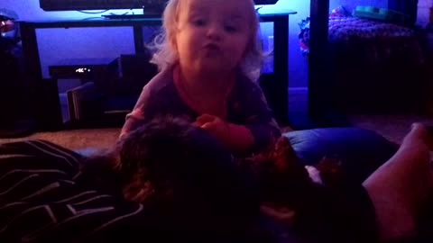 Adorable toddler talks with puppy