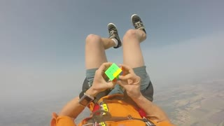 Skydiver solves Rubik's Cube while free-falling! - Video