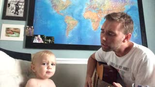 Baby adorably joins dad for guitar-playing singalong - Video