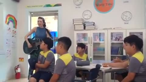 Teacher and students in Korea rehearse Justin Bieber song